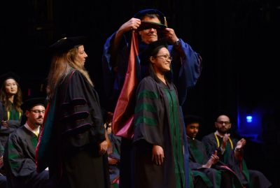 One of the highlights of the ceremony is the official hooding of each graduate.