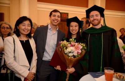 Drs. Jenn Park and Ryan Duffy are flanked by friends and family.