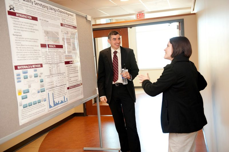 students Timothy Gall and Rebecca Kirschner discuss a research project.