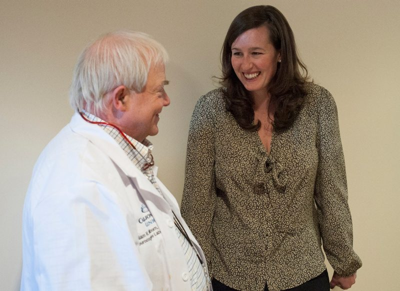 student Ashley Gerrish speaks with Carilion Clinic doctor, William R. Wellborn.