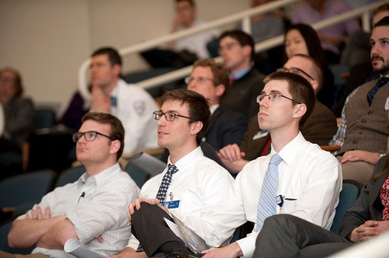 Virginia Tech Carilion School of Medicine students watch their classmate's presentation.