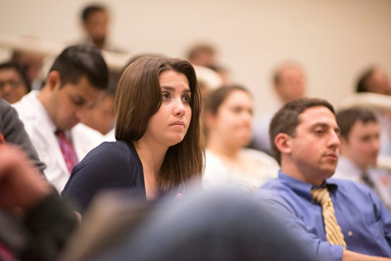 Erin Straight, a member of the Class of 2015, listens during the oral presentations.