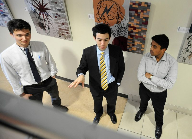 James Dittmar explains his research project to fellow Class of 2015 member Sam Bircher, and Rohit Dasgupta, a member of the Class of 2018.
