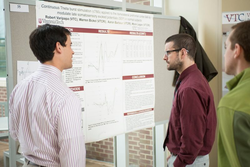 Robert Varipapa explains his research project to his fellow medical students.