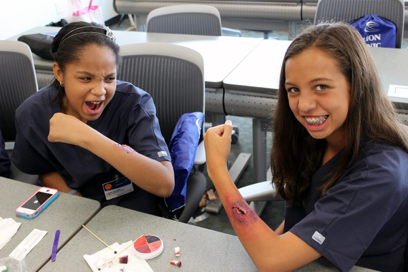 Two participants in Camp Carilion show off the gashes they gave themselves using makeup.