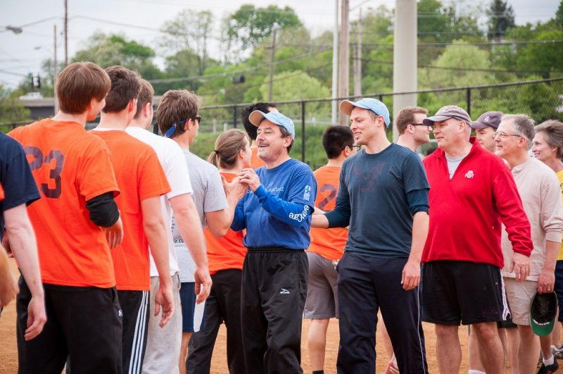 A close call: Rick Vari, associate dean for medical education, congratulates the students after falling short of a win by a couple of runs.