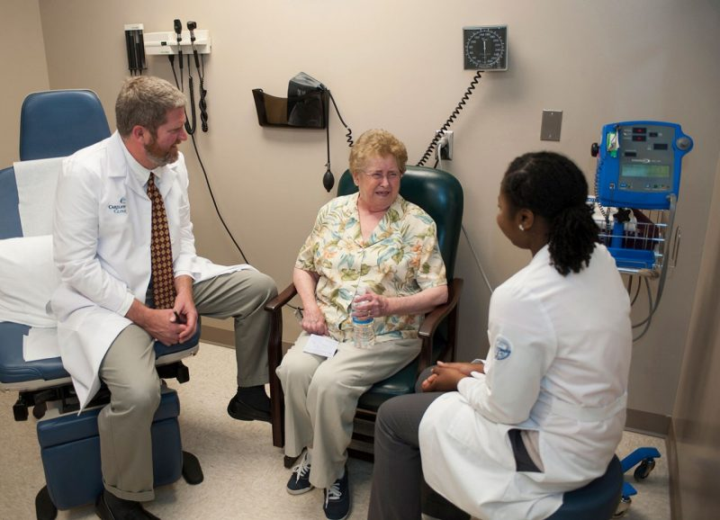 Dr. David Trinkle and Shareefah Stanley consult with a patient