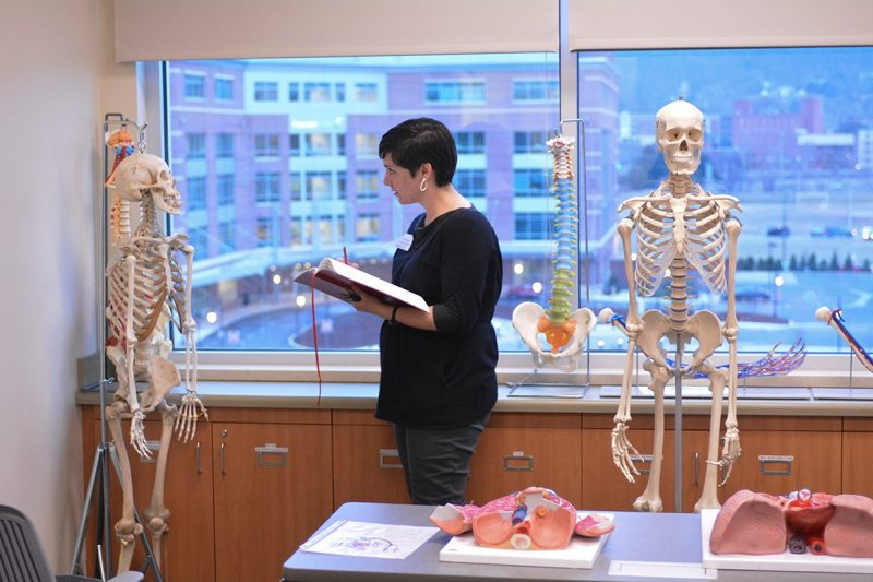 Jennifer Anderson, assistant professor of art at Hollins University, sketches a skeleton in one of the school's anatomy labs
