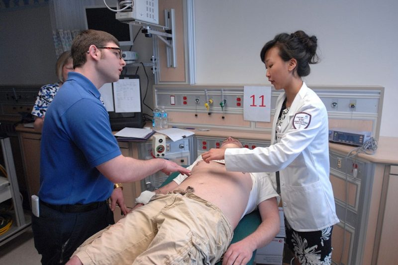 Student Sanghee Suh working with other healthcare professionals.