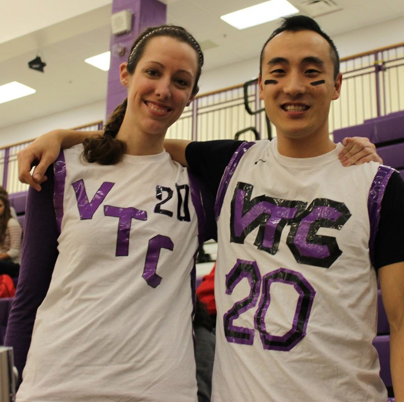 Katherine Somers and Eric Kim, both with war paint on their faces