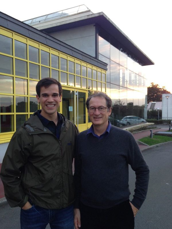 Robbie Varipapa '15 stands with Dr. Thierry Lugbull outside Memorial Hospital in Saint-Lô France.