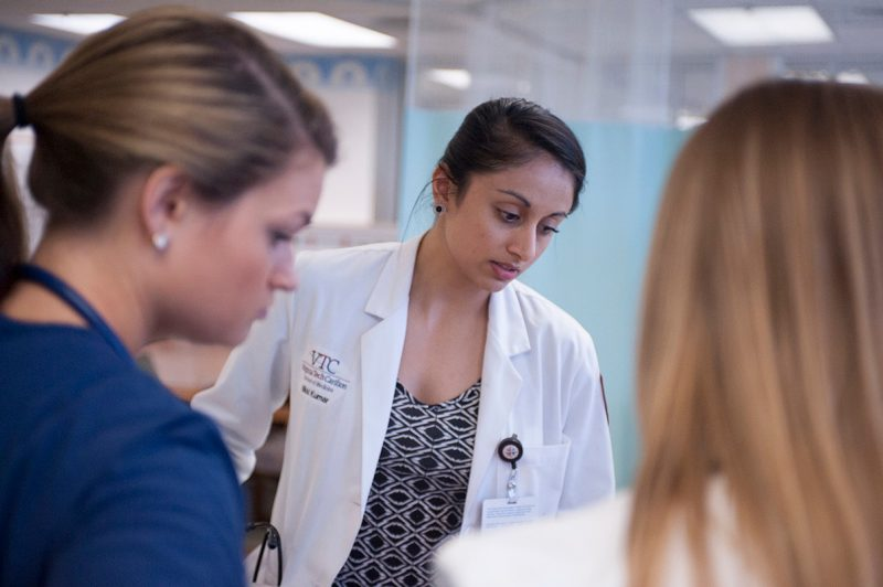 Nikki Kumar '16 works with her team to assess a patient's condition.
