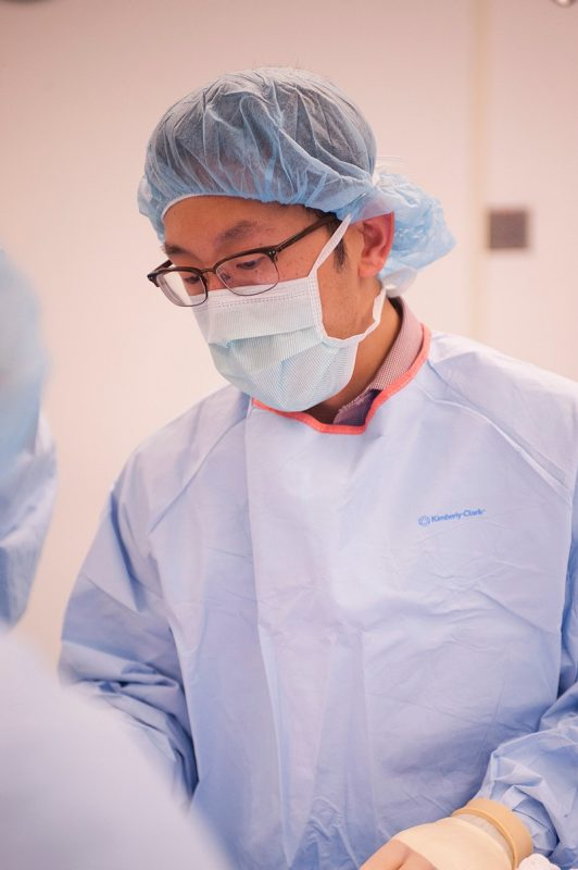 Yu-Wei Chang '16 is ready to begin surgery on a mock victim who needs a leg amputation.