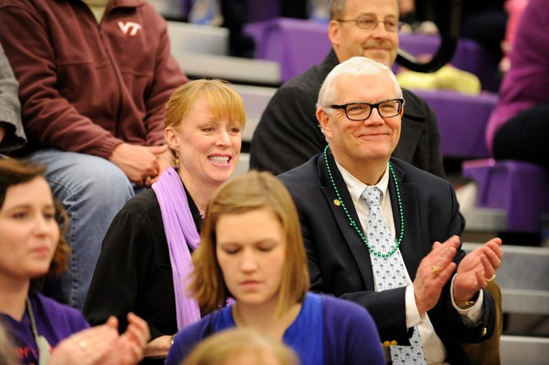 "Dan and Gil Harrington watch medical students face doctors in the 4th annual ""Docs for Morgan"" benefit basketball game."