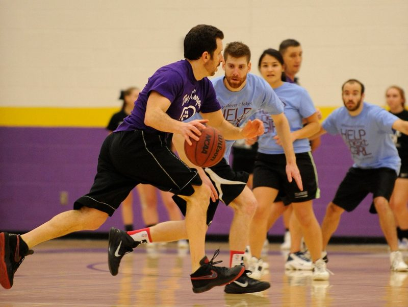 "A player drives to the basket during the 4th annual ""Docs for Morgan"" basketball game."