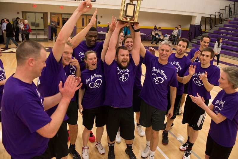 """Docs"" raise a trophy after winning the 4th annual ""Docs for Morgan"" basketball game."