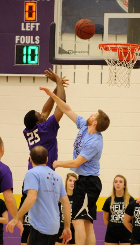 "Players go up for a rebound during the 4th annual ""Docs for Morgan"" basketball game."