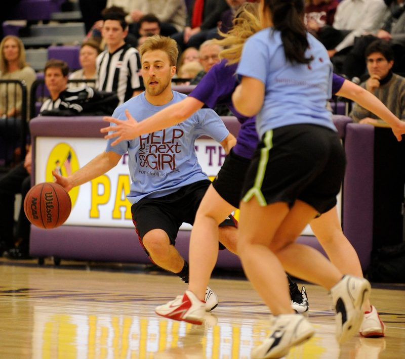 "Third Year medical student Dan Krakauer drives to the basket during the 4th annual ""Docs for Morgan"" basketball game."