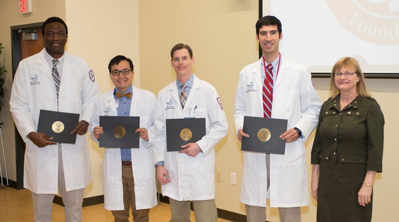 Mason Ayobello, MD, Richard Ha, DO, Matt Joy, MD and Jonatan Noguiera, DO are joined by Dean Cynda Johnson, MD as Resident Inductees. Not shown are Matthew Cauchi, DO, John Jeffries, MD, Kristin Liebrecht, MD, Jennifer Wells, MD and Midhuna William, MD.