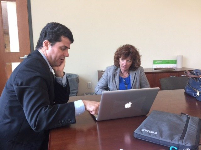 Dr. Gustavo Pinto visits with local newspaper reporter Luanne Rife.