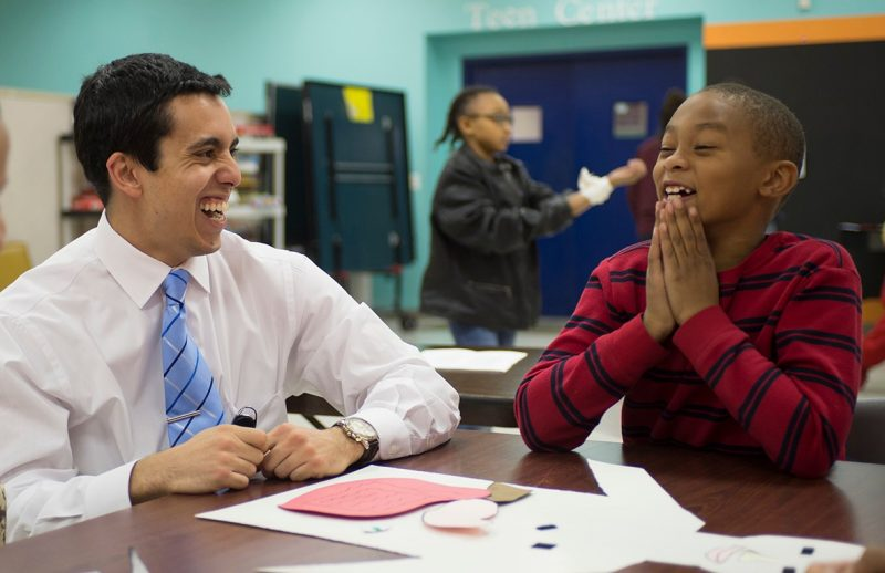 First year medical student Malek Bouzaher shares a laugh with a member of the Boys and Girls Club of Southwest Virginia.
