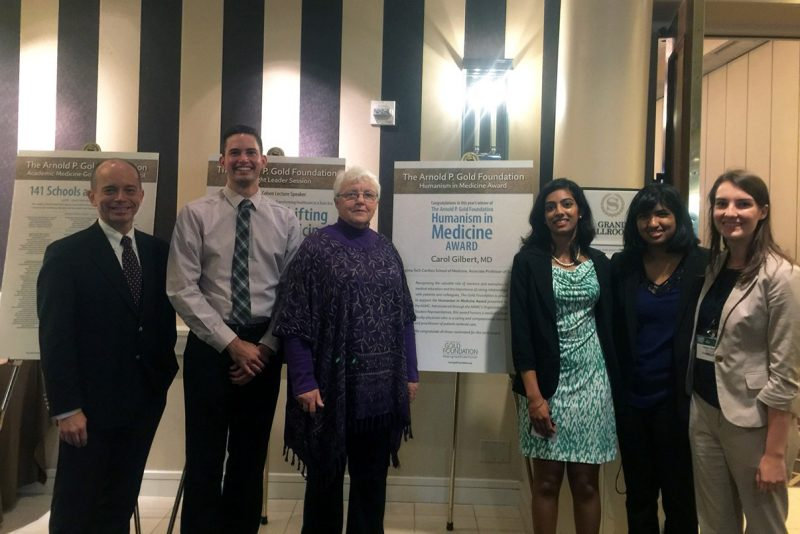 Carol Gilbert with Aubrey Knight, associate dean for students affairs, and the school's OSR representatives who put together her nomination: second-year student Cody Roberts, fourth-year student Silpa Thaivalappil, third-year student Alyssa Savelli, and first-year student Anisha Chada, during an awards luncheon.