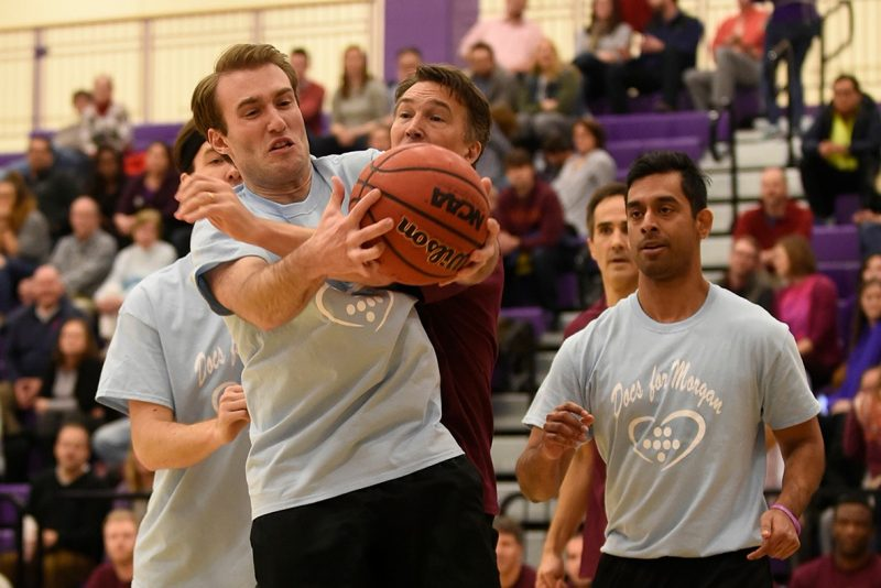 3rd year medical student Scott Fligor fights for a rebound