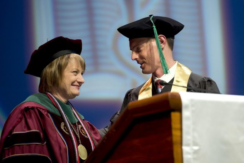 Matt Joy receives the Dean's Special Recognition by Dr. Cynda Johnson.
