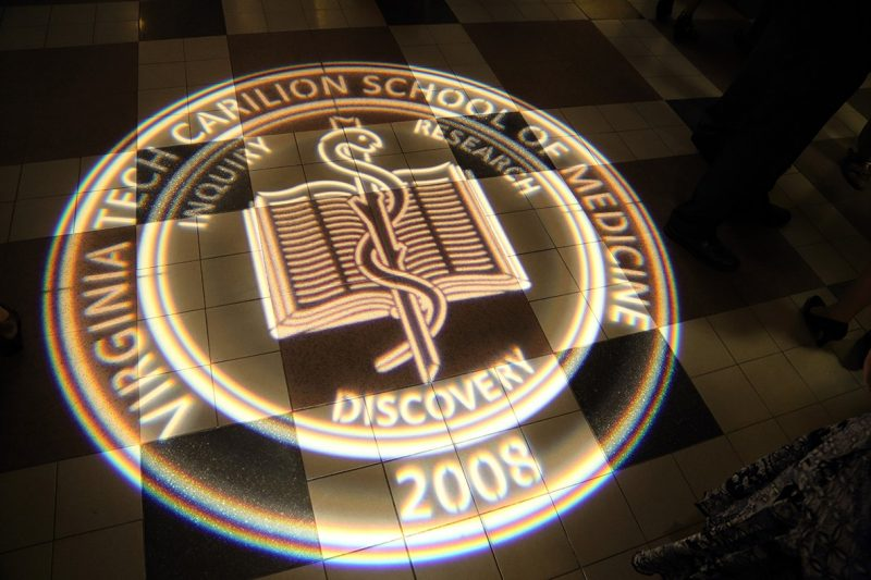 Virginia Tech Carilion School of Medicine's seal projected onto the floor of Jefferson Center