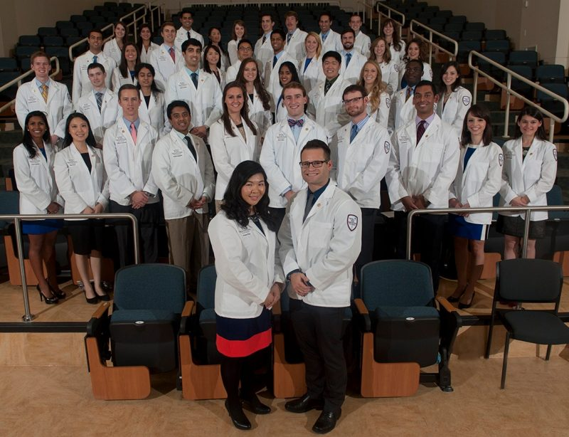 The Class of 2018 in their white coats