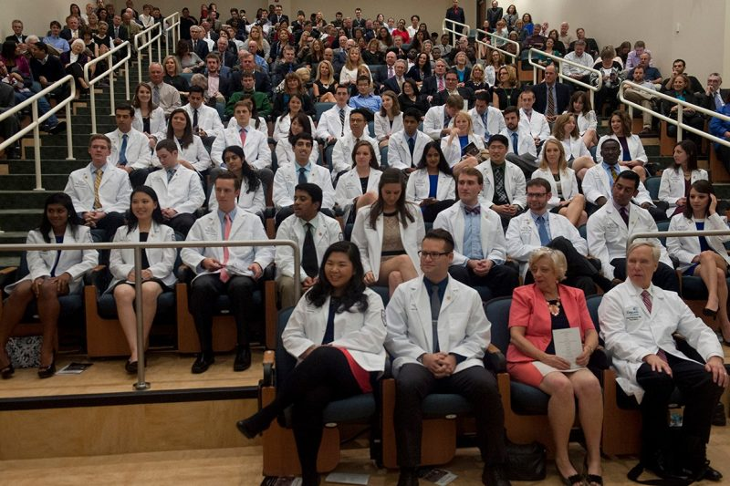 The members of the Class of 2018 in their white coats for the first time.