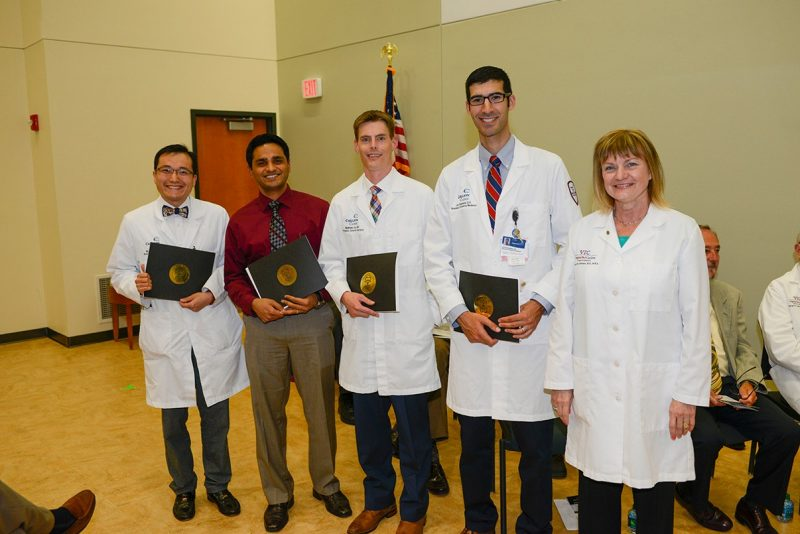Dean Cynda Johnson stands with four Carilion Clinic resident physicians who were recognized for outstanding contributions by the Virginia Tech Carilion School of Medicine's Class of 2017.