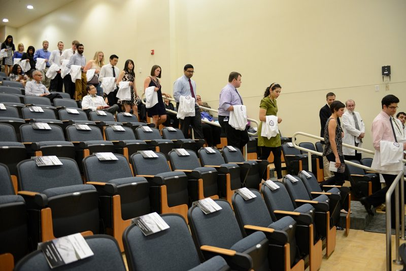 Members of the Virginia Tech Carilion School of Medicine's Class of 2017 file in and take their seats for the Student Clinician's Ceremony.