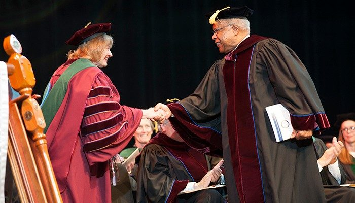 Dean Cynda Johnson greets guest speaker Dr. Louis Sullivan, founding dean of the Morehouse School of Medicine.
