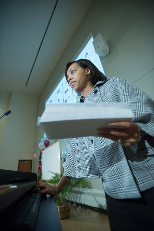 Angelica Stovall, business manager for student affairs, holds the magic envelopes.