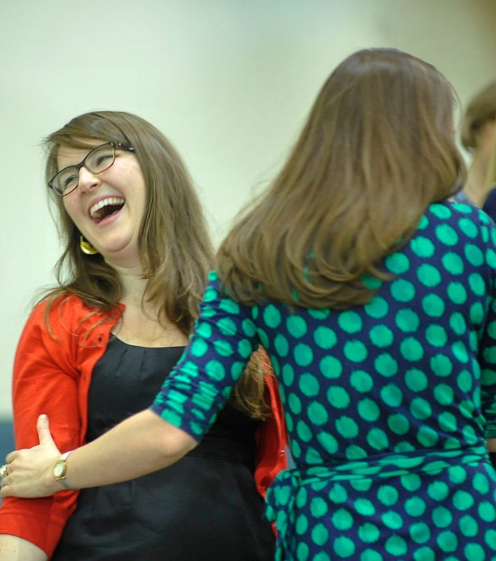 Student Lauren Poindexter and Elizabeth Gilliam hug as their matches are revealed