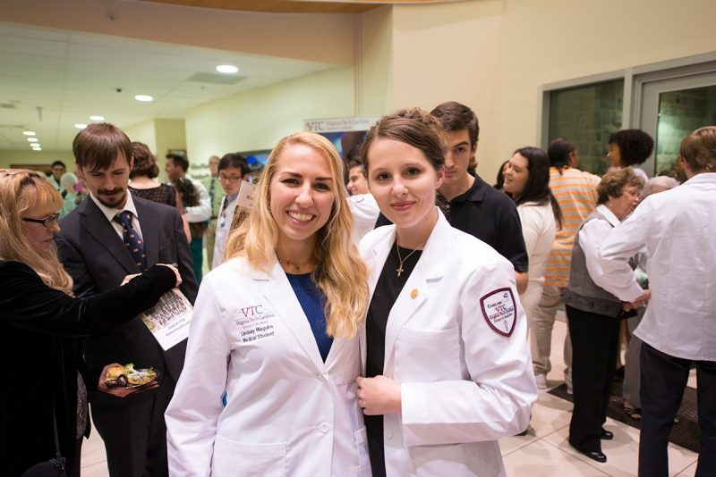 Lindsay Maguire (left) and Ellen Hammett of the Virginia Tech Carilion School of Medicine's Class of 2019 poses for a photo during a reception after the school's white coat ceremony.