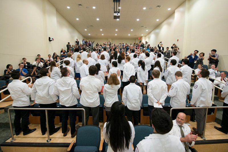 Members of the Virginia Tech Carilion School of Medicine's Class of 2019 applauds family and friends after receiving their white coats.