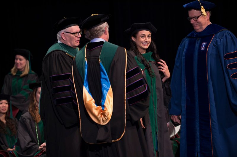 Dr. Nikki Kumar of the Class of 2016 of the Virginia Tech Carilion School of Medicine is hooded during graduation ceremonies.