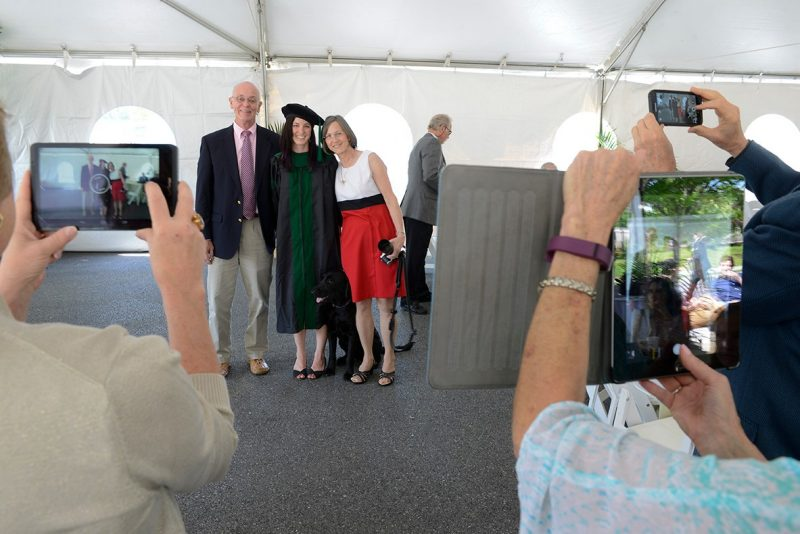 Multiple cameras are focused on Dr. Lauren Cantwell and guests during the commencement reception.