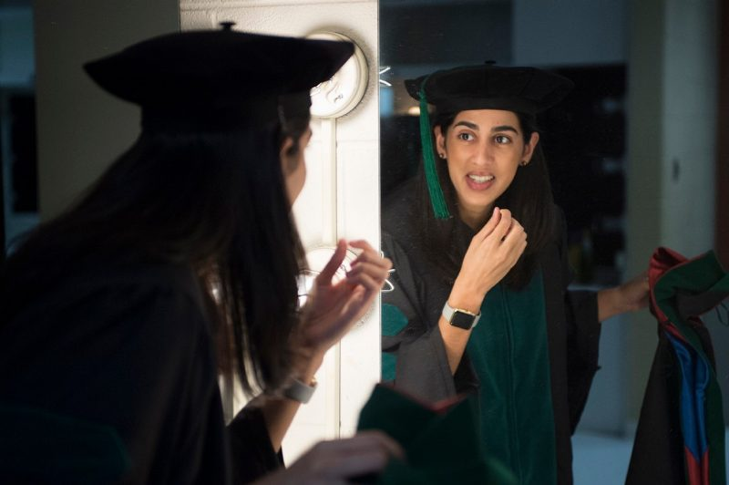 Jaspreet Hira takes a final look in the mirror prior to graduation.