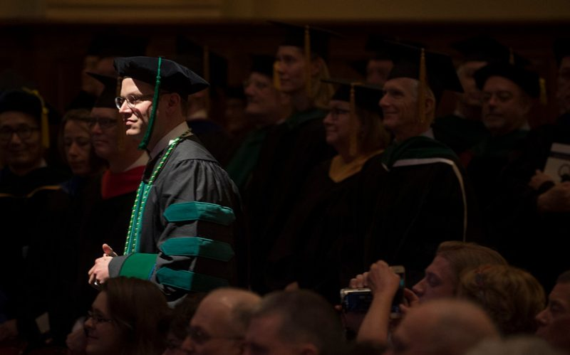 Student Matthew Yanoff in the spotlight as he walks to the stage
