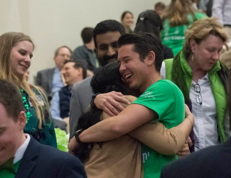 Fourth-year medical students Christopher Li hugs Tarangi Sutaria during Match Day celebrations.