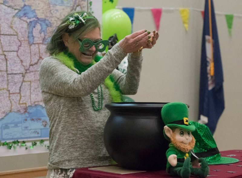 In observance of sharing St. Patrick's Day with Match Day, Dean Cynda Johnson dresses as a leprechaun with a pot of gold during Match Day celebrations.