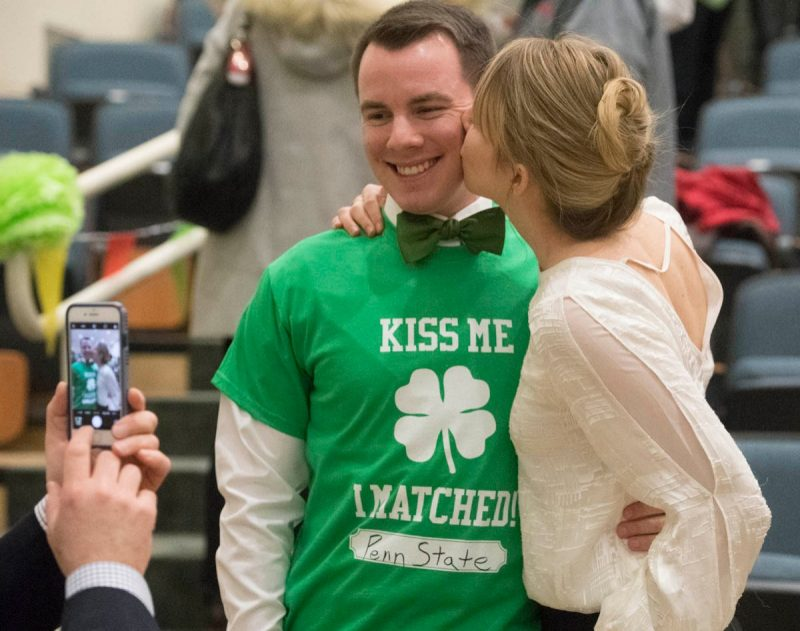 Third-year student Caroline Reist kisses fourth-year student Christopher McLaughlin