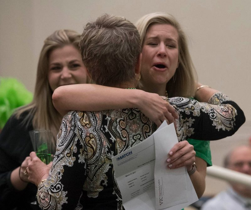 Kendall Hancock breaks out with emotion and hugs a family member as she reads her Match Day letter.
